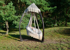 Suspension hammock seat with pillows outdoors Royalty Free Stock Photos