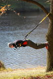Suspension outdoor workout. Man at the training at the river royalty free stock photography