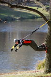 Suspension outdoor workout. Man at the training at the river royalty free stock photos