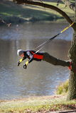 Suspension outdoor workout. Man at the training at the river stock photography