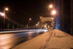 Suspension steel bridge at night Stock Photos