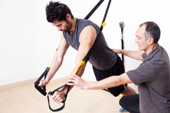 Suspension stretching exercise Royalty Free Stock Photos