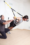 Suspension training with coach Stock Image