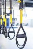 Suspension training. Suspention training straps in fitness studio Royalty Free Stock Photos
