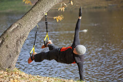Suspension workout  at the river Royalty Free Stock Photos