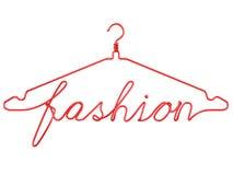 Suspensiones de ropa rojas del alambre con el mensaje - MODA Imagen de archivo libre de regalías