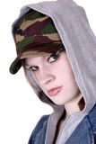 Suspicious. Attractive teen wearing camouflage hat, jean jacket and lip ring. Isolated against a white backdrop Stock Photography