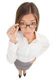 Suspicious angry secretary taking off her glasses Stock Images