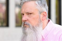 Suspicious bearded man peering to the side. With an intent contemplative expression royalty free stock photo
