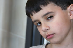 Suspicious Boy. Adorable child with an expression of distrust on his face Stock Photography