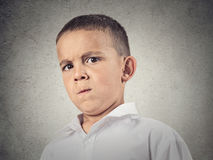Suspicious boy, full of skepticism Stock Image
