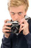 Suspicious boy photographing through retro camera Royalty Free Stock Photo