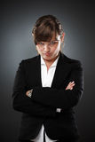 Suspicious businesswoman Royalty Free Stock Photo