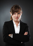 Suspicious businesswoman Stock Images