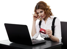 Suspicious businesswoman with credit card Royalty Free Stock Photography