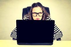 Suspicious businesswoman Stock Image