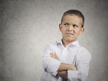 Suspicious, cautious child boy looking with disbelief stock images
