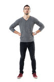 Suspicious distrustful man with hands on hips looking at camera. Full body length portrait isolated over white studio background Stock Photography