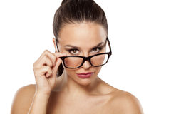 Suspicious girl with glasses Stock Images