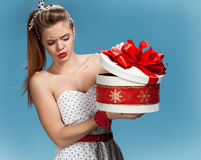 Suspicious girl opening gift box Stock Images
