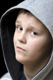 Suspicious hooded boy Stock Photography