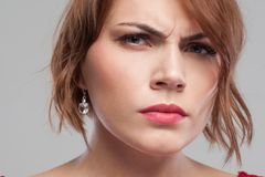 Suspicious look. Distrust in partner. Relationships problems, angry female portrait on grey background closeup, suspicion concept Royalty Free Stock Image