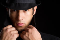 Suspicious Man. Suspicious sinister man wearing hat stock photography