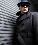 Suspicious man. In a trench coat and sunglasses Stock Photos