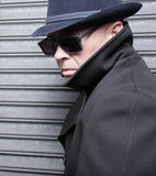 Suspicious man. In a trench coat and sunglasses Stock Photo