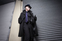Suspicious man in a coat. Suspicious man in a trench coat Royalty Free Stock Photo