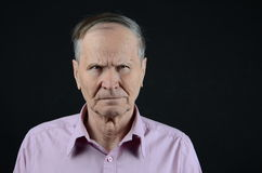 Suspicious man. Suspicious and offended old man Royalty Free Stock Photos