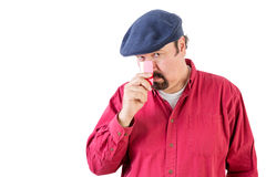 Suspicious man peering over his credit card Royalty Free Stock Image