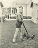 Suspicious man  with a push reel lawn mower Royalty Free Stock Photography