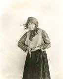 Suspicious peasant woman Stock Photos
