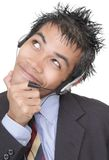 Suspicious smiling telemarketer portrait Royalty Free Stock Image