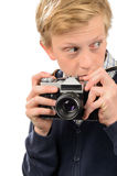 Suspicious teenage boy holding retro camera Stock Image