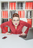 Suspicious woman boss looking at you. Suspicious woman boss in eyeglasses looking at you Royalty Free Stock Photos