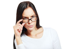 Suspicious woman. Pretty suspicious woman posing with glasses Royalty Free Stock Image
