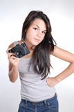 Suspicious young girl with old photocamera Royalty Free Stock Images