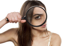 Suspicious young woman Stock Photo