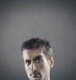Suspiciousness. Facial expression: doubt and suspiciousness. copy space Royalty Free Stock Photo