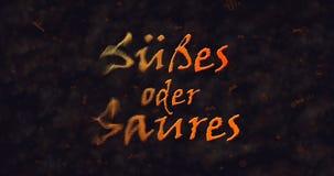 Susses oder Saures y x28; Truco o Treat& x29; Texto alemán que disuelve en el polvo de la izquierda Fotografía de archivo libre de regalías