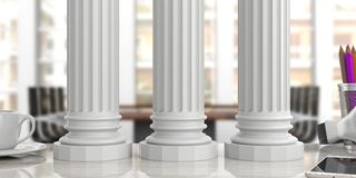 Three classical pillars on an office desk, blur background. 3d illustration. Sustainability concept.Three classical pillars on an office desk, blurred background Stock Images
