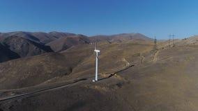 Green energy windmill turbine rotating at farm. Sustainability construction of windfarm converter kinetic windpower. Rotor wind-turbine blade smooth circling stock video footage