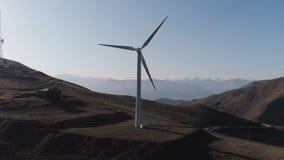 Green energy windmill turbine rotating at farm. Sustainability construction of windfarm converter kinetic windpower. Rotor wind-turbine blade smooth circling stock footage
