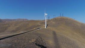Green energy windmill turbine rotating at farm. Sustainability construction of windfarm converter kinetic windpower. Rotor wind-turbine smooth circling, infinite stock footage