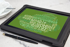 Sustainability word cloud. Tablet with go green word cloud royalty free stock photos
