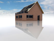 Sustainable brick house with solar pannels Royalty Free Stock Photo