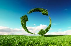 Sustainable development, eco friendly lifestyle concept. 3d rend. Ering of arrow circle icon on fresh spring meadow with blue sky in background Royalty Free Stock Images