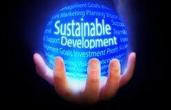 Sustainable Development blue background plan. Sustainable Development globe yellow blue globe Stock Photo
